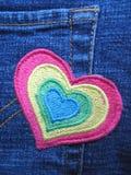 Cuore filettato sui jeans Fotografia Stock Libera da Diritti