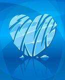 Cuore ghiacciato rotto su priorità bassa blu Fotografie Stock Libere da Diritti