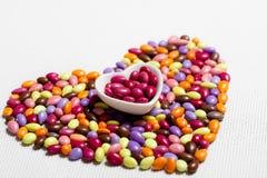 Cuore lustrato variopinto delle caramelle Fotografia Stock