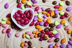 Cuore lustrato variopinto delle caramelle Fotografie Stock