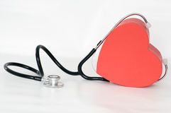 Cuore matto. Heart listening to itself by means of a stethoscope stock photo