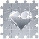 Cuore metallico di puzzle Immagini Stock