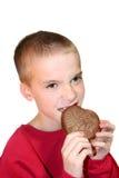 Cuore mordace 1 del cioccolato del ragazzo intenso Fotografia Stock Libera da Diritti