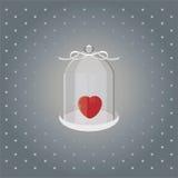 Cuore nell'ambito di cuore di vetro sopra con il nastro bianco su un fondo grigio Fotografia Stock