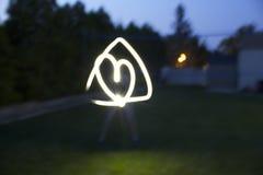 Cuore nell'immagine della luce del triangolo fotografia stock