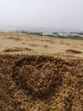 Cuore per una spiaggia immagini stock