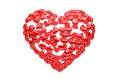 Cuore rosso composto di piccoli cuori manny - rappresentazione 3d - Fotografie Stock