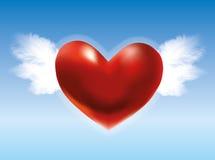Cuore rosso con le ali nel cielo blu Fotografie Stock