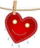 Cuore rosso della tessile su un clothesline Fotografie Stock Libere da Diritti