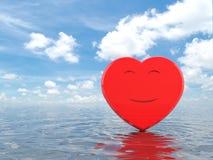 Cuore rosso di sorriso su acqua Fotografie Stock