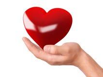 Cuore rosso a disposizione Concetto di amore Immagini Stock Libere da Diritti