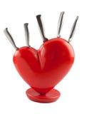 Cuore rosso e coltello che mostrano amore di alimento Fotografie Stock Libere da Diritti