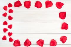 Cuore rosso su un fondo di legno Fotografia Stock