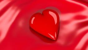 Cuore rosso sulla coperta del raso Fotografia Stock