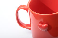 Cuore rosso sulla tazza rossa Fotografie Stock Libere da Diritti