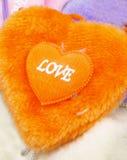 Cuore sfocato arancione fotografia stock libera da diritti