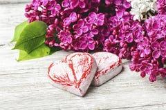 Cuore simbolico di amore e del lillà Fotografia Stock