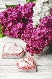 Cuore simbolico di amore e del lillà Fotografie Stock