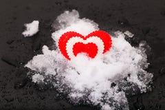 Cuore su neve Immagine Stock