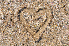 Cuore sul fondo della sabbia Immagini Stock Libere da Diritti
