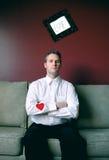 Cuore sul suo manicotto Fotografie Stock Libere da Diritti