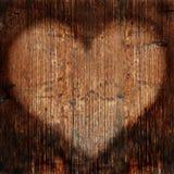 Cuore sulla parete di legname Fotografia Stock