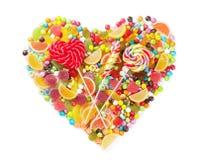 Cuore variopinto delle caramelle, della gelatina e della marmellata d'arance Immagine Stock Libera da Diritti
