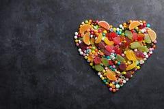 Cuore variopinto delle caramelle, della gelatina e della marmellata d'arance Fotografia Stock Libera da Diritti