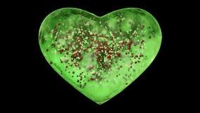 Cuore verde girante di vetro del ghiaccio con le palle rosse dei fiocchi di neve dentro l'alfa ciclo opaco illustrazione di stock
