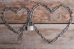 Cuori a catena con la serratura Fotografia Stock