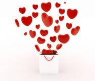 Cuori che cadono come regali in un supermercato della borsa Il concetto di un regalo con amore Fotografia Stock