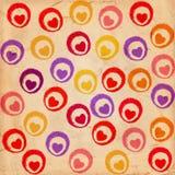Cuori colorati su vecchio documento Immagine Stock