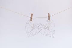 Cuori con il modello floreale su un fondo di carta strutturata Fotografia Stock
