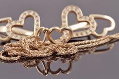Cuori dei gioielli dell'oro Fotografie Stock Libere da Diritti