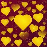 Cuori dell'oro su un'astrazione marrone rossiccio del fondo immagini stock libere da diritti