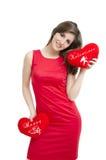 Cuori della tenuta della ragazza dei biglietti di S. Valentino immagine stock libera da diritti