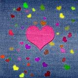 Cuori di colore sui jeans Fotografie Stock