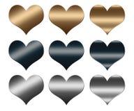Cuori fatti del metallo dell'argento e dell'oro, segno di AMORE Fotografia Stock
