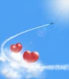 Cuori in nuvole e airplan Fotografie Stock