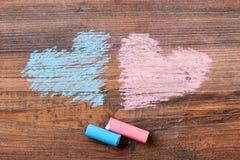 Cuori rosa e blu del gesso Immagine Stock