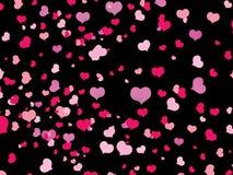 Cuori rosa in un ordine casuale su fondo nero Fotografie Stock