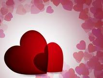2 cuori rossi con fondo di molti il piccolo cuori per il giorno di biglietti di S. Valentino fotografie stock libere da diritti