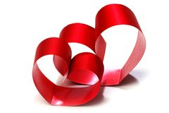 Cuori rossi dell'arco del nastro Fotografia Stock