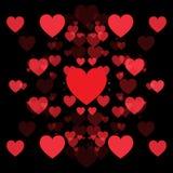 Cuori rossi e fondo nero Immagini Stock