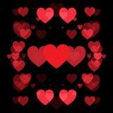 Cuori rossi e fondo nero Fotografia Stock