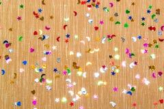 Cuori, stelle gialle e lune del witl del fondo di scintillio e scintillare piccoli Vista superiore Fotografia Stock