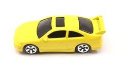 Cupé amarillo del coche del juguete Fotografía de archivo libre de regalías