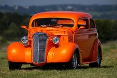 Cupé clásico de la naranja del coche imagen de archivo