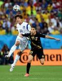 Cupê du monde 2014 de Kevin Mirallas e de Hong Jeong-ho Fotos de Stock