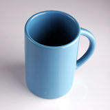 Cup. Blue cup on the white table royalty free stock photography
